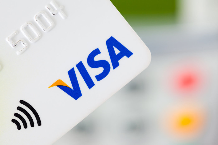 stock-photo-bath-uk-january-close-up-of-a-contactless-visa-credit-card-with-a-card-machine-in-the-172239644
