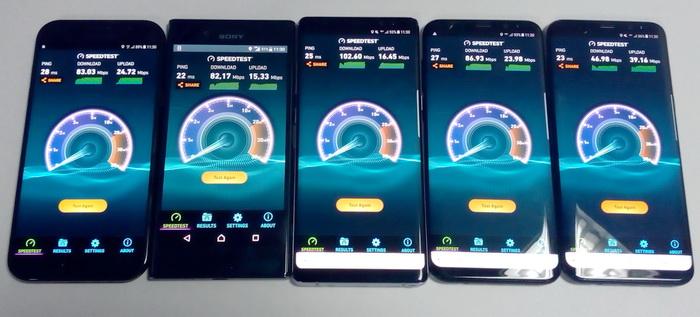 Наступний тест: 5 смартфонів, на яких одночасно запущено додаток Speedtest. Швидкість upload знизилася до 42...86 Мбіт/с, швидкість upload − до 15...39 Мбіт/с